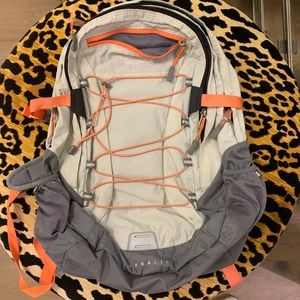 North Face orange and grey backpack